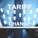 "Man Holding tablet with Arrows and text ""Tariff"" ""Change"""